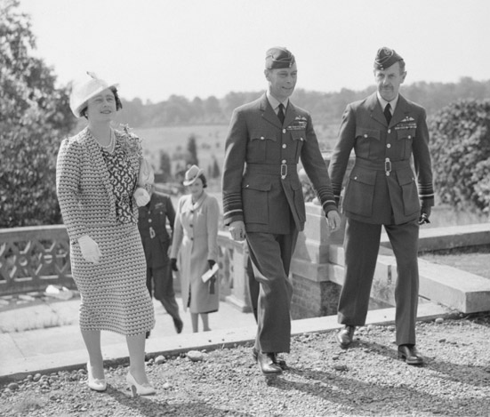 King George VI and Queen Elizabeth, escorted by Air Chief Marshal Sir Hugh Dowding, Air Officer Commander-in-Chief of Fighter Command, visit the Headquarters of Fighter Command at Bentley Priory, near Stanmore, Middlesex, in September 1940. Photo: © IWM